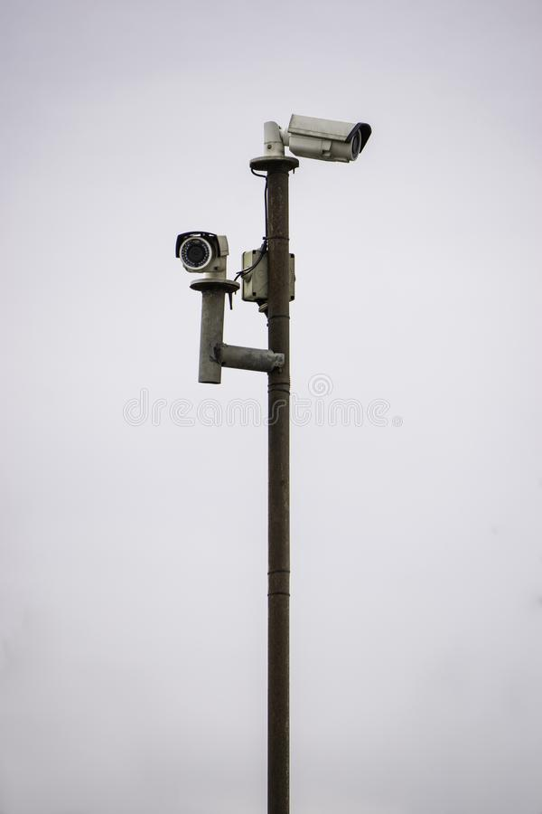 Surveillance cameras on the pillar royalty free stock photos