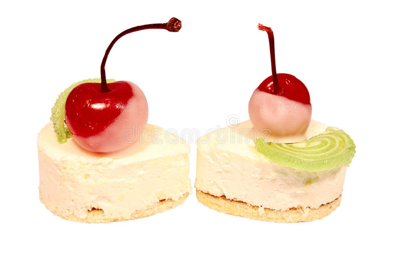 Two sweet cake with cherry on top. Isolated on white background stock photography