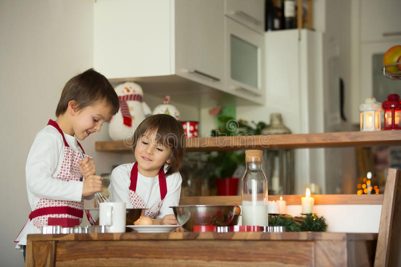 Two sweet children, boy brothers, preparing gingerbread cookies stock images