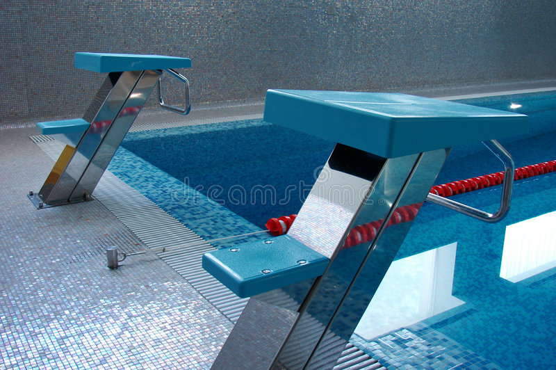Two swimming start places stock image