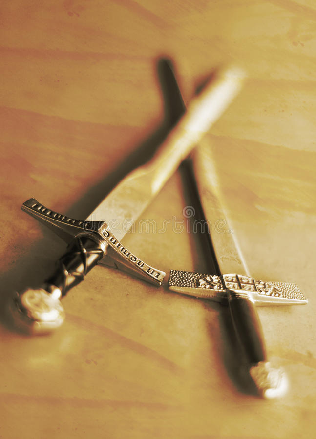 Two swords. Crossed medieval swords close up stock images