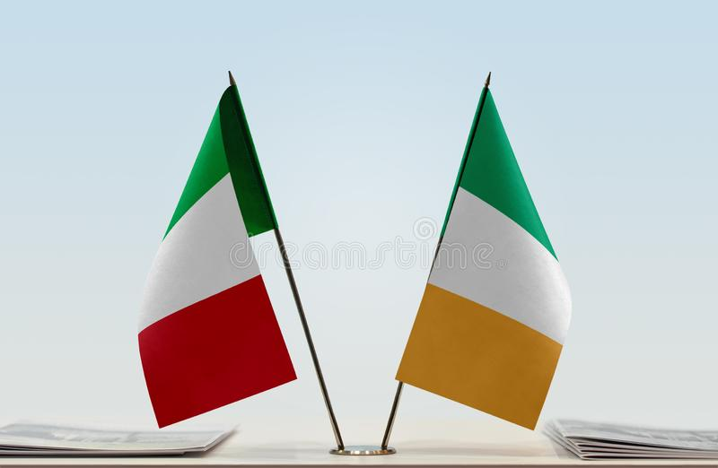 Flags of Italy and Ireland. Two table flags of Italy and Ireland royalty free stock photos