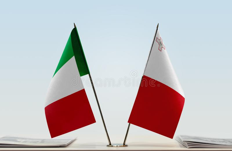 Flags of Italy and Malta stock image
