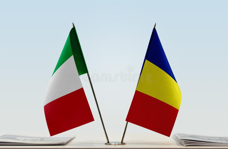 Flags of Italy and Romania. Two table flags of Italy and Romania royalty free stock image