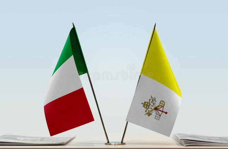 Flags of Italy and Vatican. Two table flags of Italy and Vatican royalty free stock photography