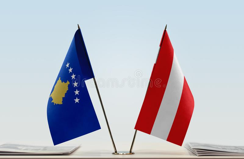 Flags of Kosovo and Austria. Two table flags of Kosovo and Austria stock image