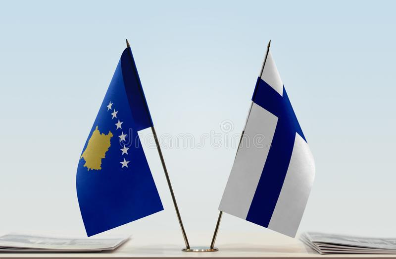 Flags of Kosovo and Finland. Two table flags of Kosovo and Finland royalty free stock photos