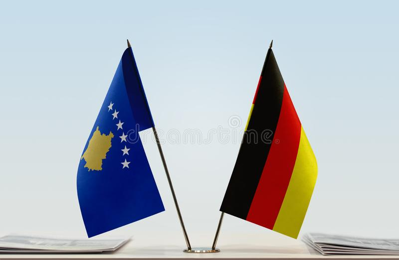 Flags of Kosovo and Germany. Two table flags of Kosovo and Germany stock image