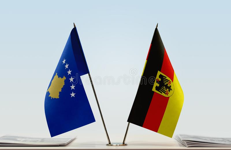 Flags of Kosovo and Germany. Two table flags of Kosovo and Germany stock photos