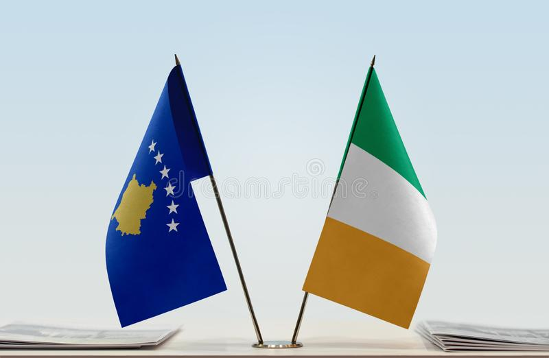 Flags of Kosovo and Ireland. Two table flags of Kosovo and Ireland stock photos