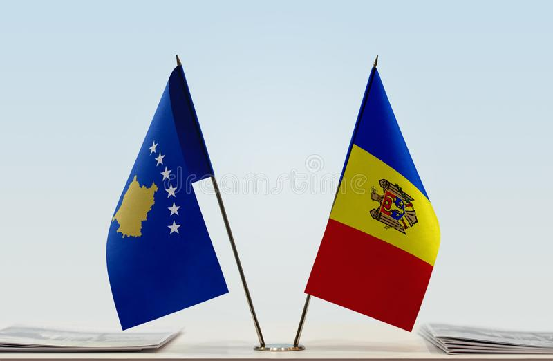 Flags of Kosovo and Moldova. Two table flags of Kosovo and Moldova stock photo