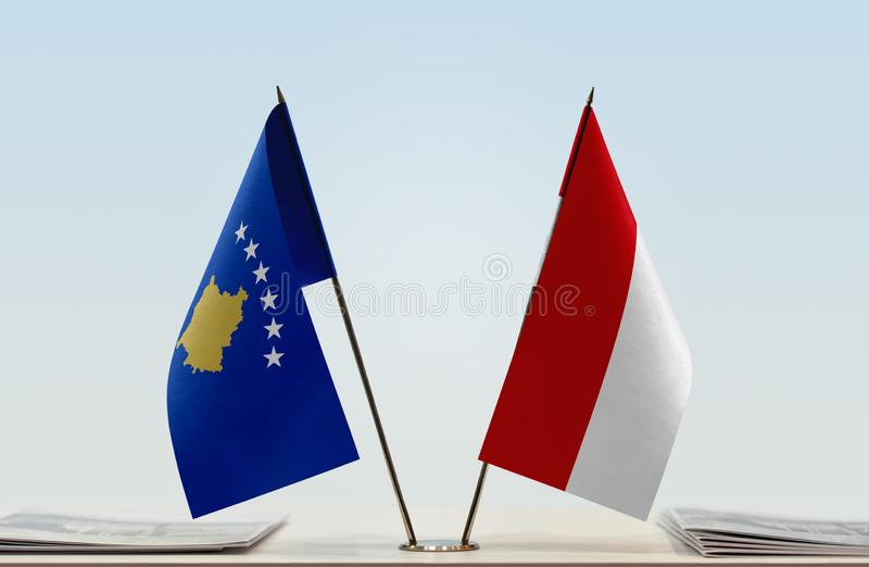 Flags of Kosovo and Monaco. Two table flags of Kosovo and Monaco stock photography