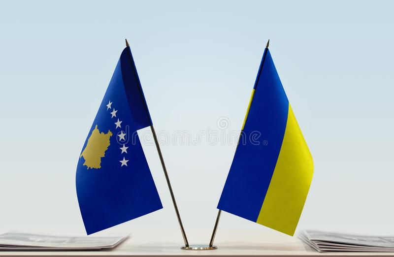 Flags of Kosovo and Ukraine. Two table flags of Kosovo and Ukraine royalty free stock photos
