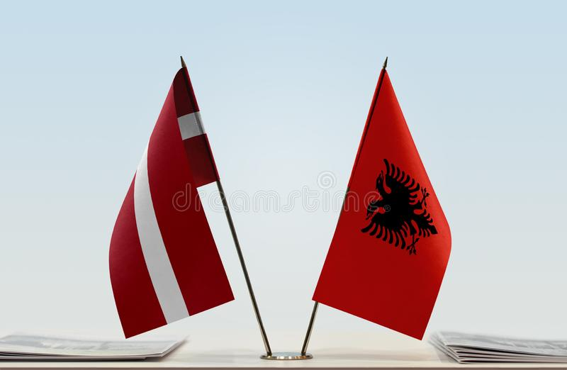 Flags of Latvia and Albania. Two table flags of Latvia and Albania royalty free stock photo