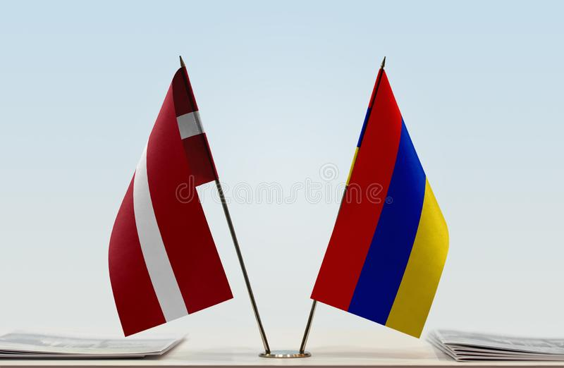 Flags of Latvia and Armenia. Two table flags of Latvia and Armenia royalty free stock image