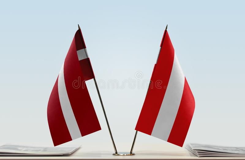 Flags of Latvia and Austria. Two table flags of Latvia and Austria royalty free stock photos