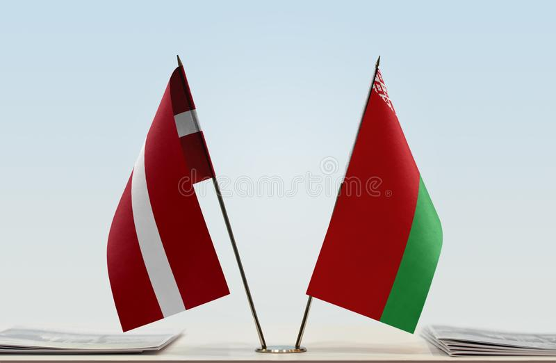Flags of Latvia and Belarus. Two table flags of Latvia and Belarus royalty free stock image