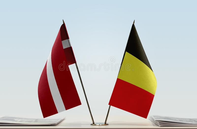 Flags of Latvia and Belgium. Two table flags of Latvia and Belgium stock image