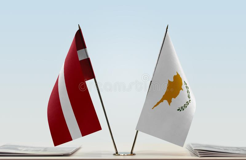 Flags of Latvia and Cyprus. Two table flags of Latvia and Cyprus royalty free stock photos