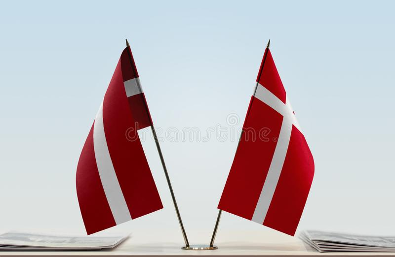 Flags of Latvia and Denmark. Two table flags of Latvia and Denmark stock photo
