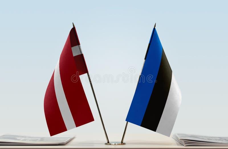Flags of Latvia and Estonia. Two table flags of Latvia and Estonia royalty free stock photos