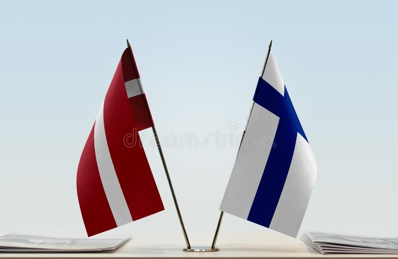 Flags of Latvia and Finland. Two table flags of Latvia and Finland royalty free stock image
