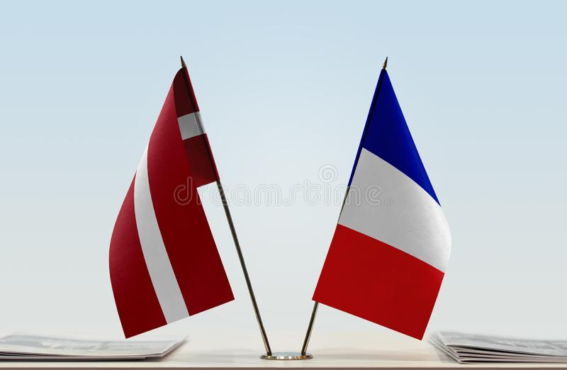 Flags of Latvia and France. Two table flags of Latvia and France stock photos