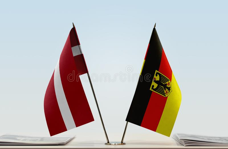 Flags of Latvia and Germany. Two table flags of Latvia and Germany stock photography