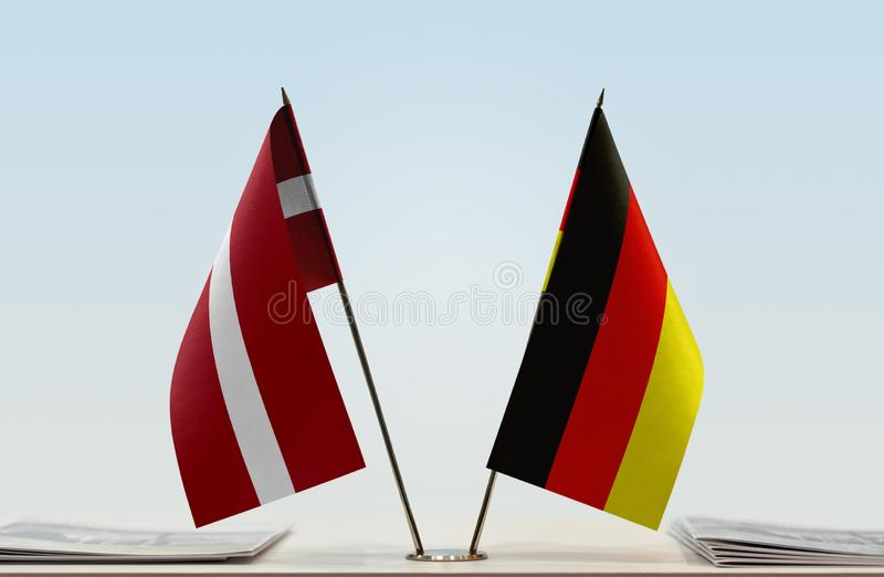 Flags of Latvia and Germany. Two table flags of Latvia and Germany stock image