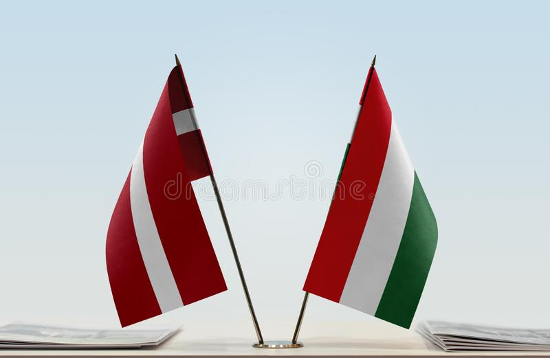 Flags of Latvia and Hungary. Two table flags of Latvia and Hungary royalty free stock photo
