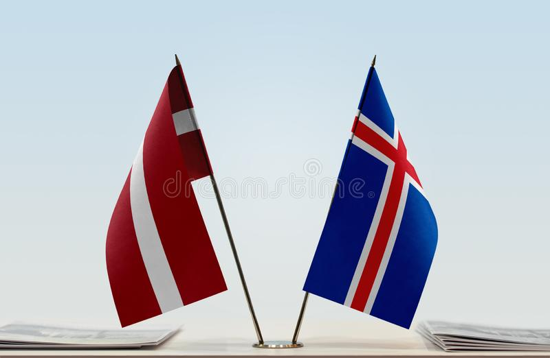 Flags of Latvia and Iceland. Two table flags of Latvia and Iceland royalty free stock images