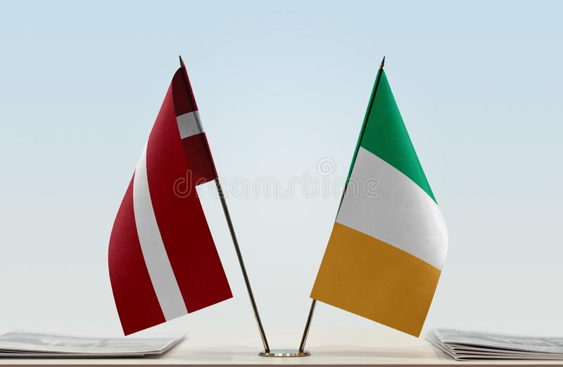 Flags of Latvia and Ireland. Two table flags of Latvia and Ireland royalty free stock images