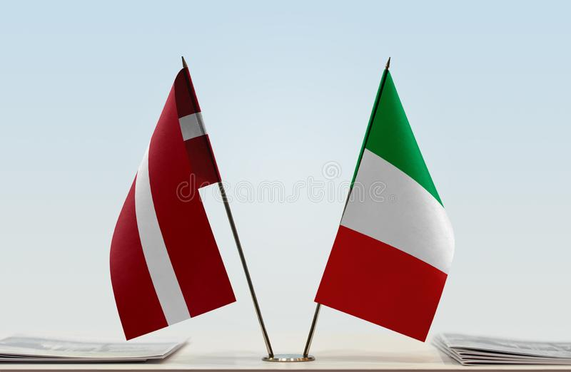 Flags of Latvia and Italy royalty free stock photography