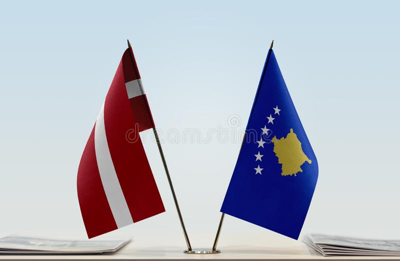 Flags of Latvia and Kosovo. Two table flags of Latvia and Kosovo stock image