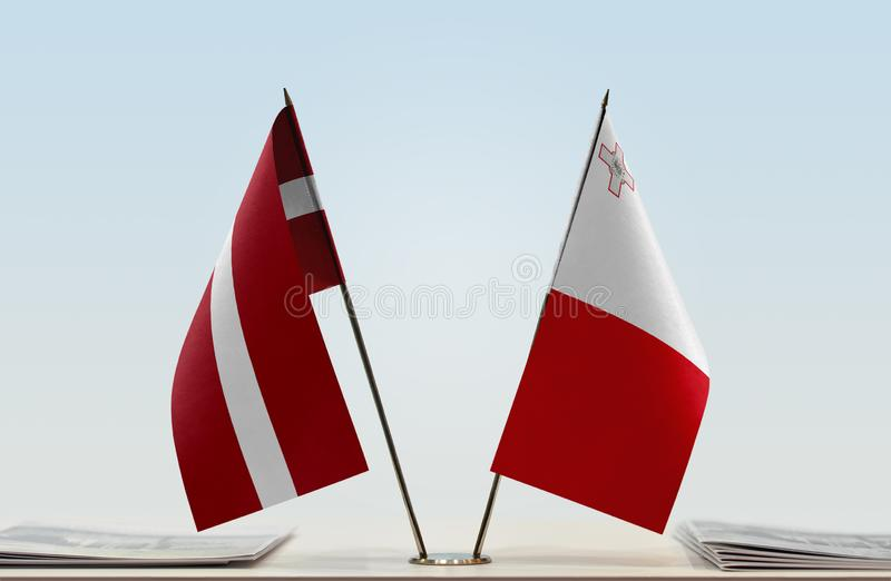 Flags of Latvia and Malta royalty free stock photo