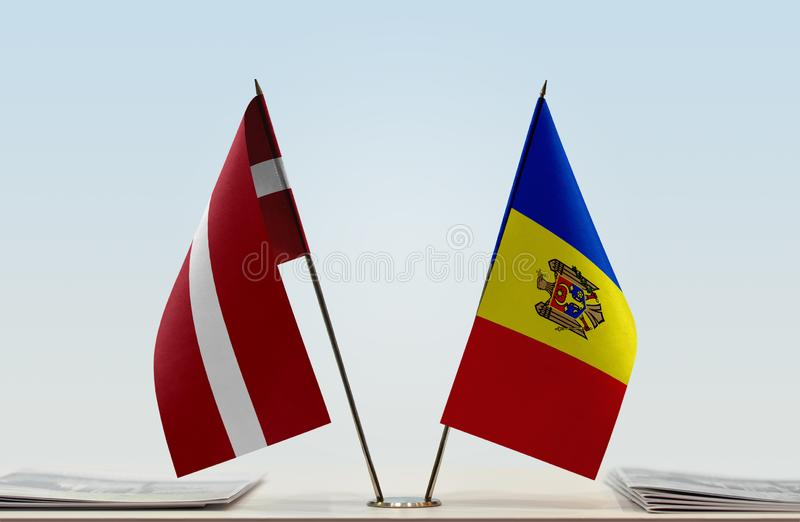 Flags of Latvia and Moldova. Two table flags of Latvia and Moldova stock images