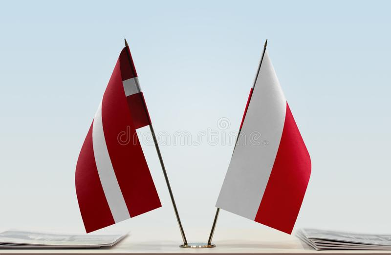 Flags of Latvia and Poland. Two table flags of Latvia and Poland stock image