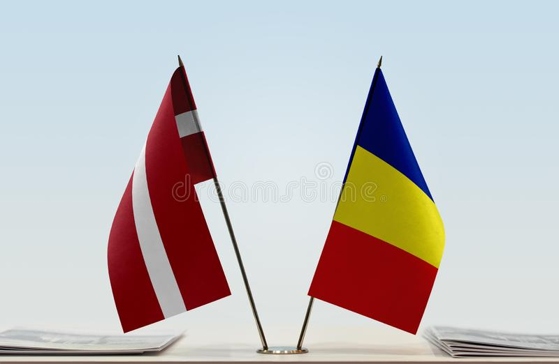 Flags of Latvia and Romania. Two table flags of Latvia and Romania stock photography