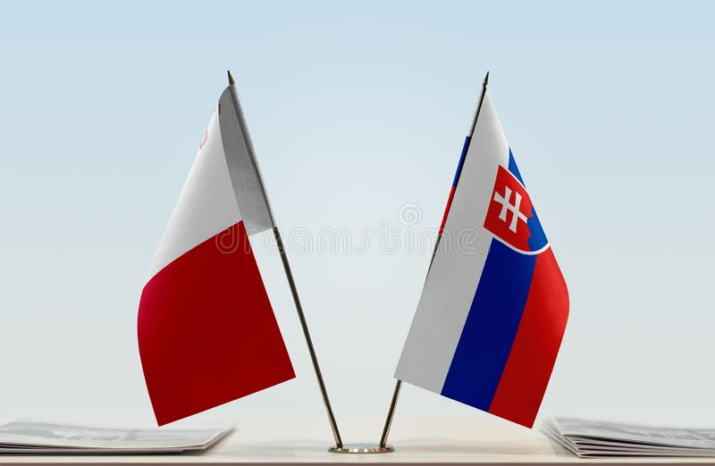 Flags of Malta and Slovakia. Two table flags of Malta and Slovakia stock images