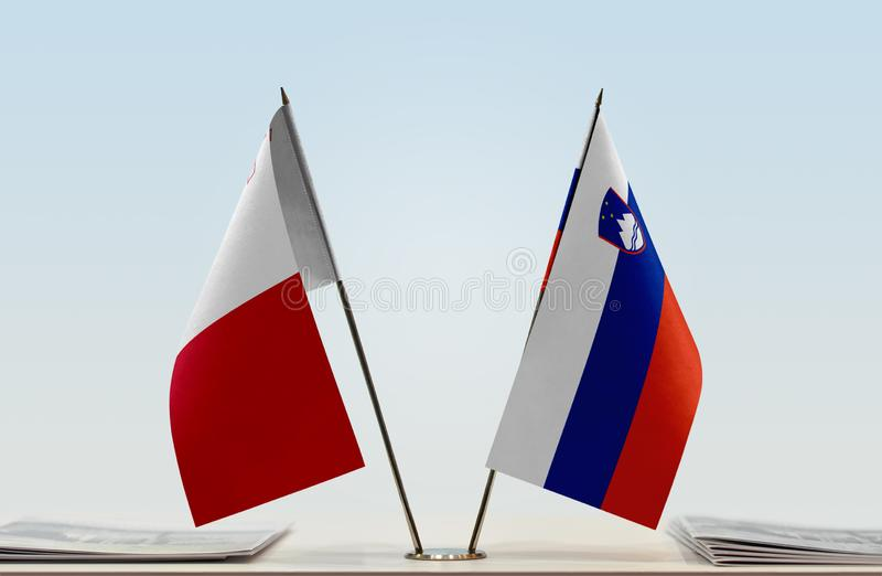Flags of Malta and Slovenia. Two table flags of Malta and Slovenia stock image