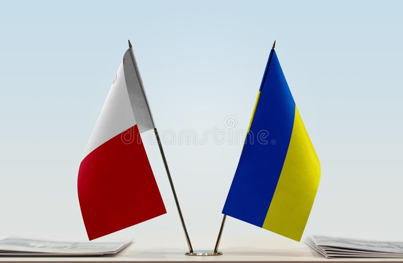 Flags of Malta and Ukraine. Two table flags of Malta and Ukraine royalty free stock photography