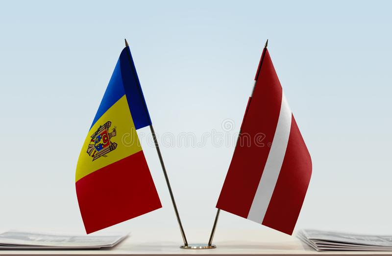 Flags of Moldova and Latvia. Two table flags of Moldova and Latvia stock images