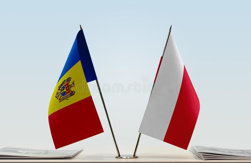 Flags of Moldova and Poland. Two table flags of Moldova and Poland stock photos