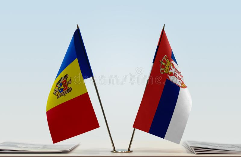 Flags of Moldova and Serbia. Two table flags of Moldova and Serbia stock images