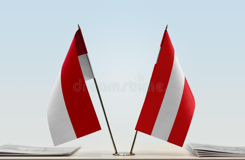 Flags of Monaco and Austria. Two table flags of Monaco and Austria stock photo