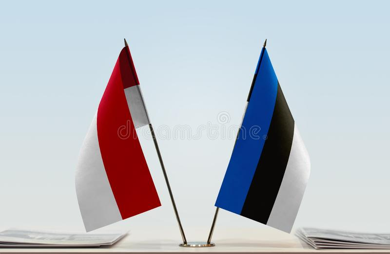 Flags of Monaco and Estonia. Two table flags of Monaco and Estonia royalty free stock photos