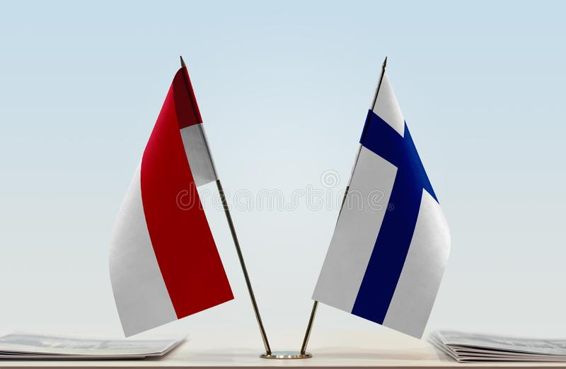 Flags of Monaco and Finland. Two table flags of Monaco and Finland royalty free stock image