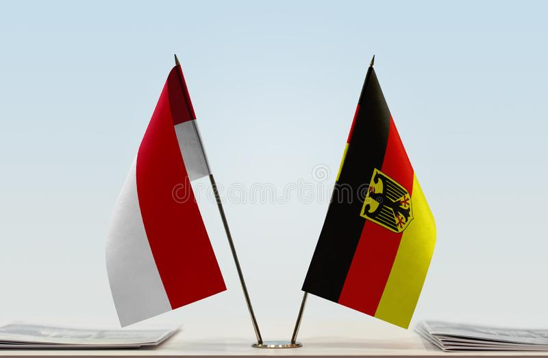 Flags of Monaco and Germany. Two table flags of Monaco and Germany royalty free stock image