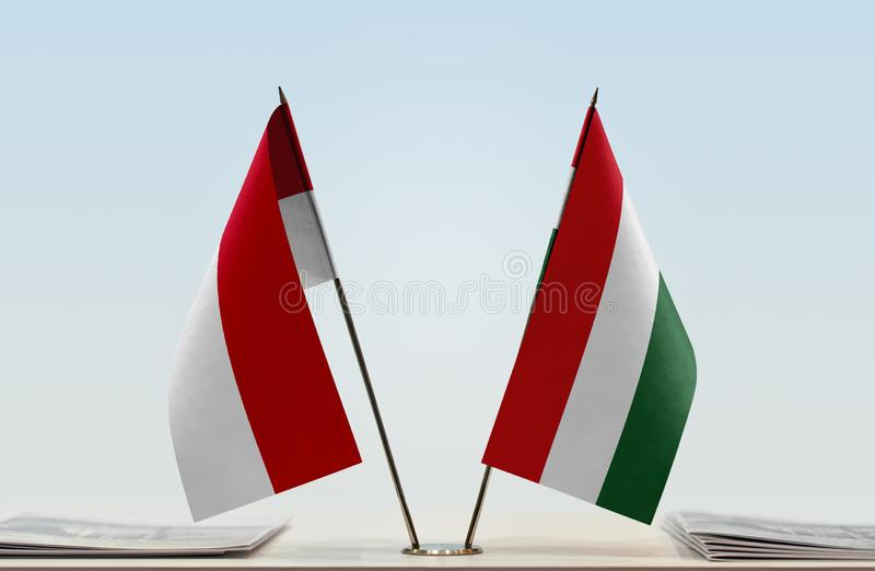 Flags of Monaco and Hungary. Two table flags of Monaco and Hungary stock photography