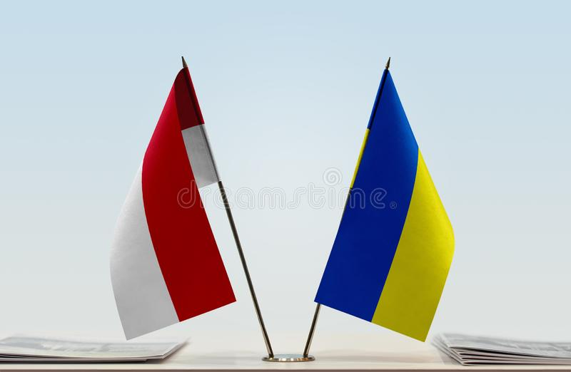 Flags of Monaco and Ukraine. Two table flags of Monaco and Ukraine stock images